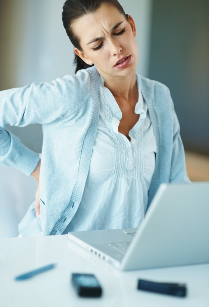 woman working at PC with back pain